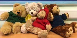 Four teddy bears in jumpers