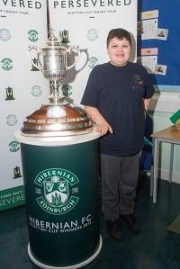 Boy standing next to Scottish Cup